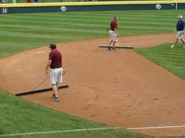 The grounds crew prepares for the second of five games in one day during the 2010 LLWS.