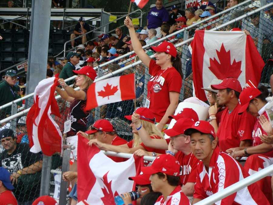 Team Canada parents celebrate a home run during its 4-2 loss to Panama at the 2010 LLWS.