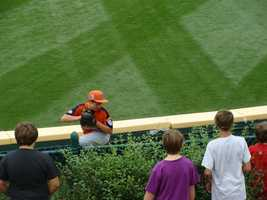 A pitcher for Toms River, N.J., warms up in the bullpen behind the left field fence at Lamade Stadium during the 2010 LLWS.