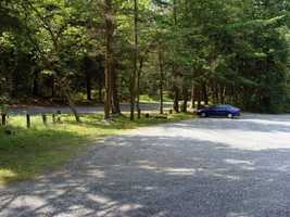 The gravel parking area is located near access to the public snowmobile trails of Michaux State Forest.
