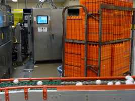 Eggs with minor cracks are diverted onto a small conveyor belt and will be sold for their liquid content.
