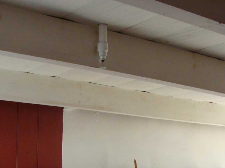 A closer look at the ceiling of the first floor reveals a sprinkler.
