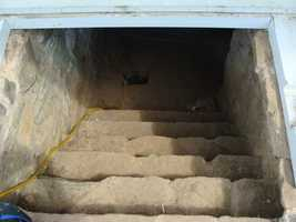 Outside, there is an entrance to the basement.
