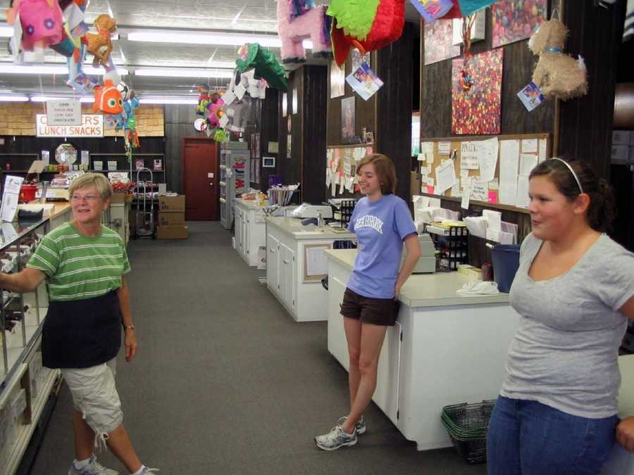 Maybelle Morgan, left, Emily Gerhart, center and MacKenzie Smith, right, enjoy a laugh while working at Smith's Candies.