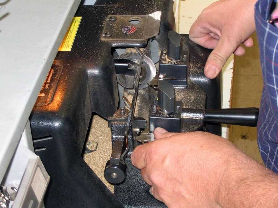 Brian Beamesderfer, store manager of Wilhelm Hardware, shows off his key-making skills.