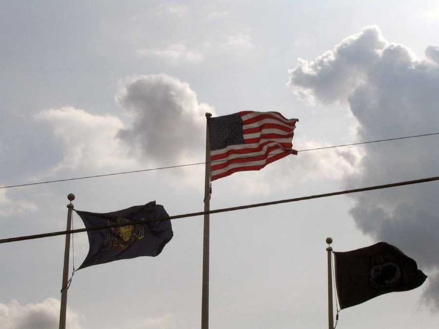 The state, national and POW-MIA flags wave outside VFW Post 6076.