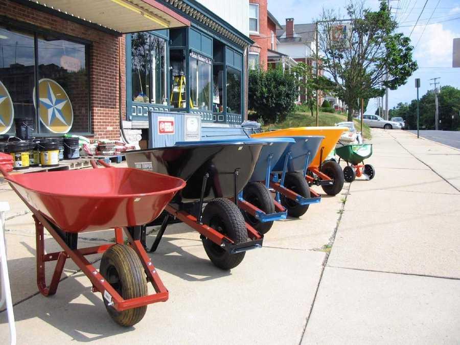 Wheel barrels line the South Railroad Street sidewalk outside Wilhelm Hardware.