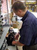 Brian Beamesderfer, store manager of Wilhelm Hardware, makes keys.