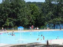 The swimming pool and spray ground sit on a bluff overlooking the lake.