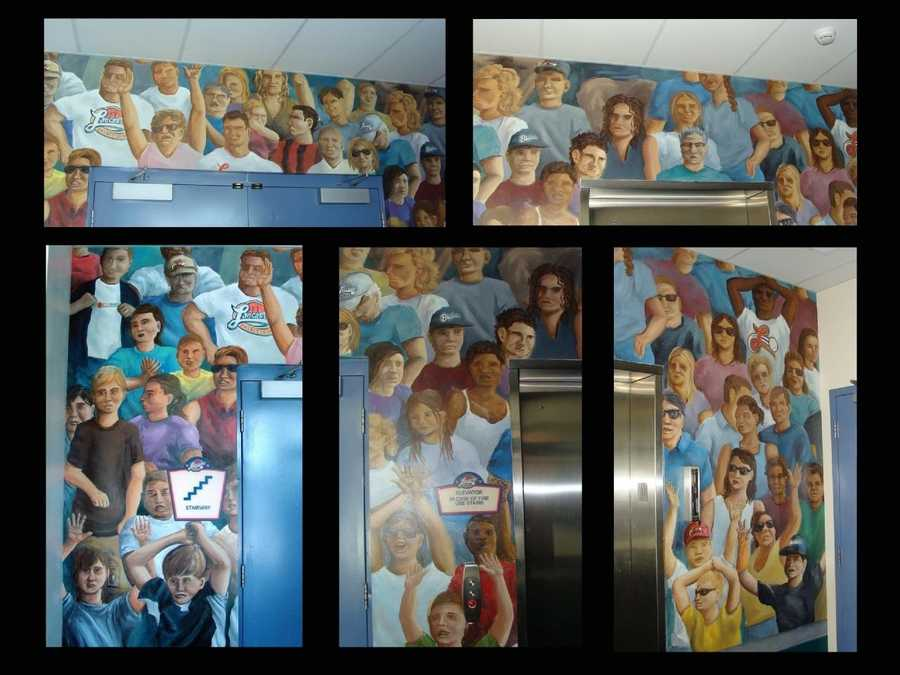 This fan mural was created by Two Dudes Painting Company. It surrounds the elevator and stairwell doors that lead to the Suite Level.