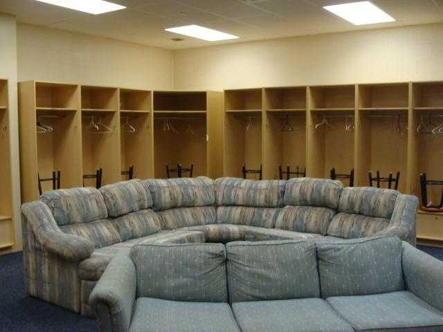 The visiting team's clubhouse is smaller than the Barnstormers' clubhouse. They don't spend as much time in the clubhouse as the Barnstormers do.