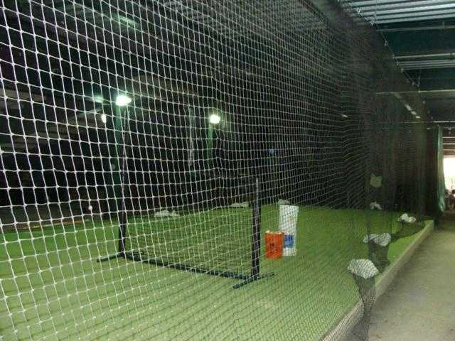 The batting cage is used by both home and visiting teams.