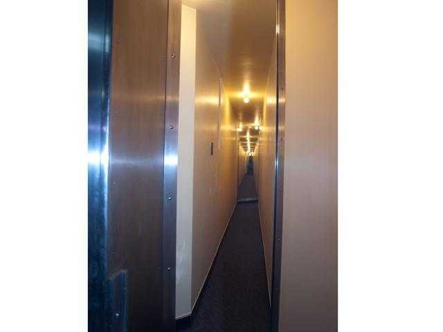 This is the Bandit Barrier. It is a series of hallways and mirrors. An armed guard could stand at the vault door, and see the entire perimeter around the vault.