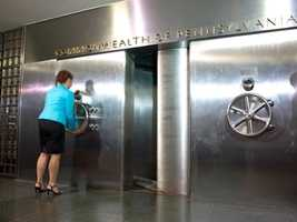 The wheel on the left spins the door. This is Lori Hetrick closing the door. There are more than 400 tons of stainless steel and concrete in the vault.
