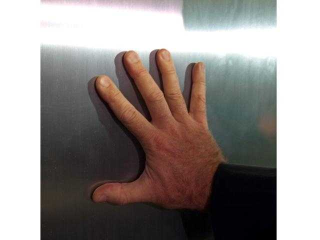 The doors are made of stainless steel. When you put your hand on it, your fingerprints are still there. This is another security feature.