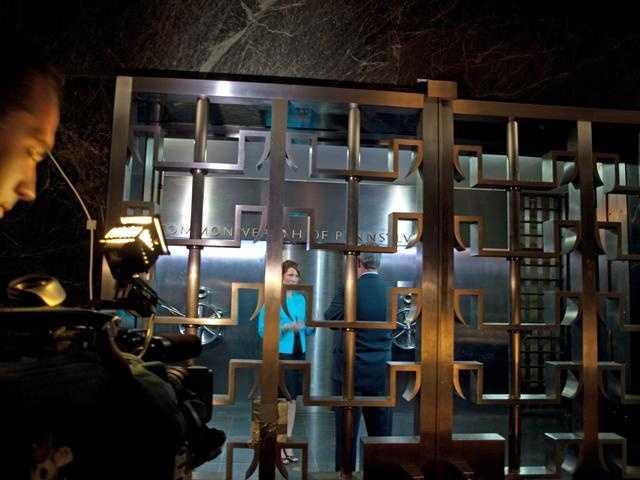 News 8 photographer Joe Mitton shoots video.