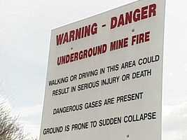"The state has erected signs with an ominous warning, ""walking or driving in this area could result in injury or death."""