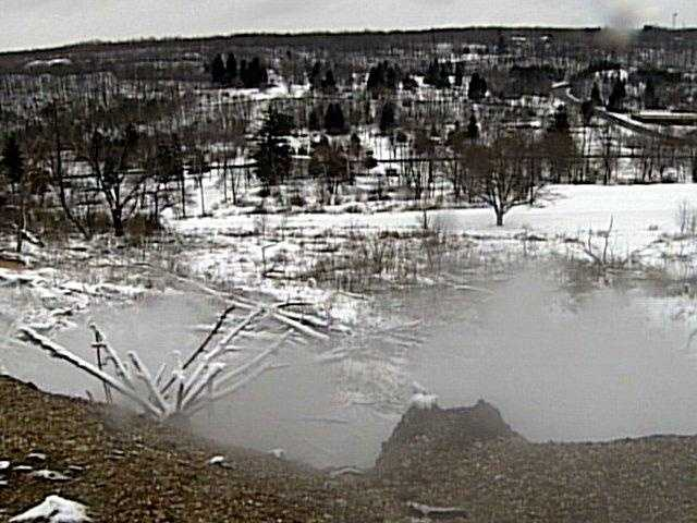 Clouds of steam put a gray filter on the bright sun. In winter, Centralia is a world of fire and ice.