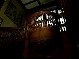 This part of the staircase is called the pulpit. It's where an entertainer would stand to perform for guests.