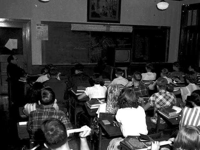 Students tune in TV in class in the 1950s.