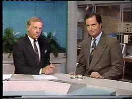 Former News 8 anchor and reporter Dick Hoxworth with News 8's Chief Meteorologist Joe Calhoun.