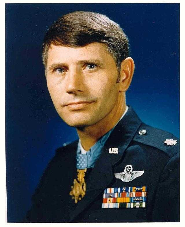 Leo K. Thorsness: U.S. Air Force, Vietnam War: As pilot of an F-105 aircraft, Thorsness' wingman was shot down by enemy fire and the crew was forced to abandon the aircraft. Thorsness relayed the crew's position to Search and Rescue, destroyed a MIG-17, and defended the crew from enemy attack despite being low on fuel.
