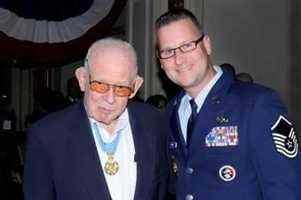 Bernard F. Fisher: U.S. Air Force, Vietnam War: Fisher risked his life by flying out of an overcast sky, skidding to the end of a runway littered with debris, picking up his wounded wingman and making it out of the A Shau Valley.