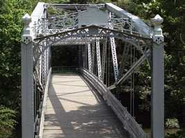 The Waterville Bridge is a cast iron structure that was built in 1890 to cross the Little Pine Creek in Lycoming County.