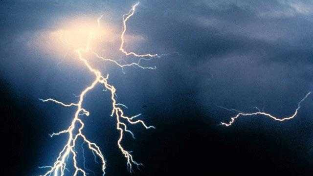 When a thunderstorm builds, negative electrical charges develop within clouds and oppositely charged particles form on the ground. The attraction between these two forces mount until the resistance of the air between them can no longer contain them. The two charges then rush to meet each other and lightning occurs.