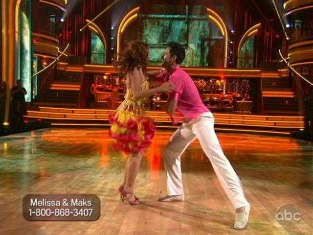 Melissa was back from injury. She and Maks danced the Salsa to a cocktail waitress routine.