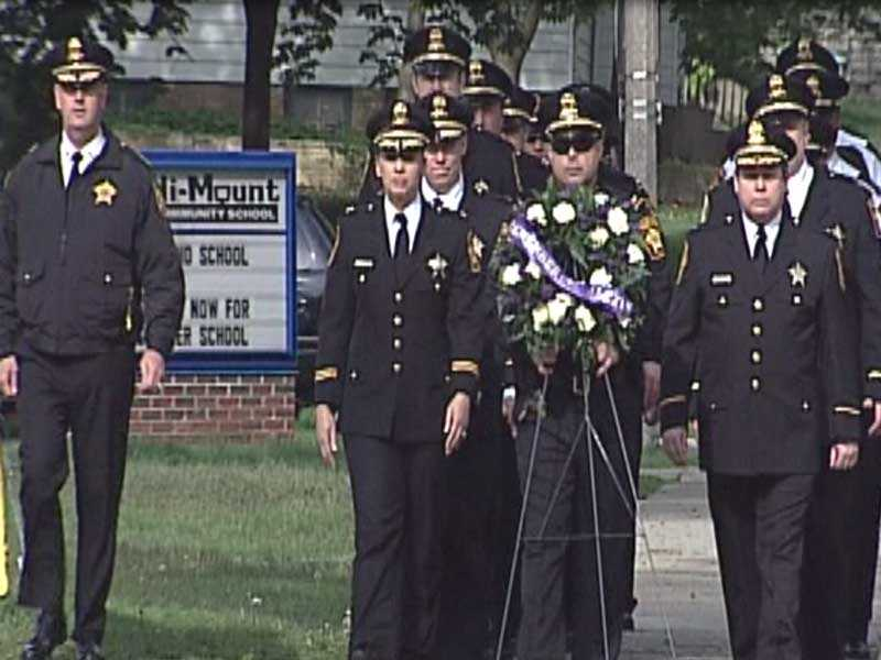 May 2012: The Milwaukee County Sheriff's Department holds its annual wreath-laying ceremony at Alexis' school.