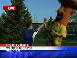 """Chorizo was so happy to be """"found"""" he was giving WISN 12 meteorologist Jeremy Nelson a high-five'."""