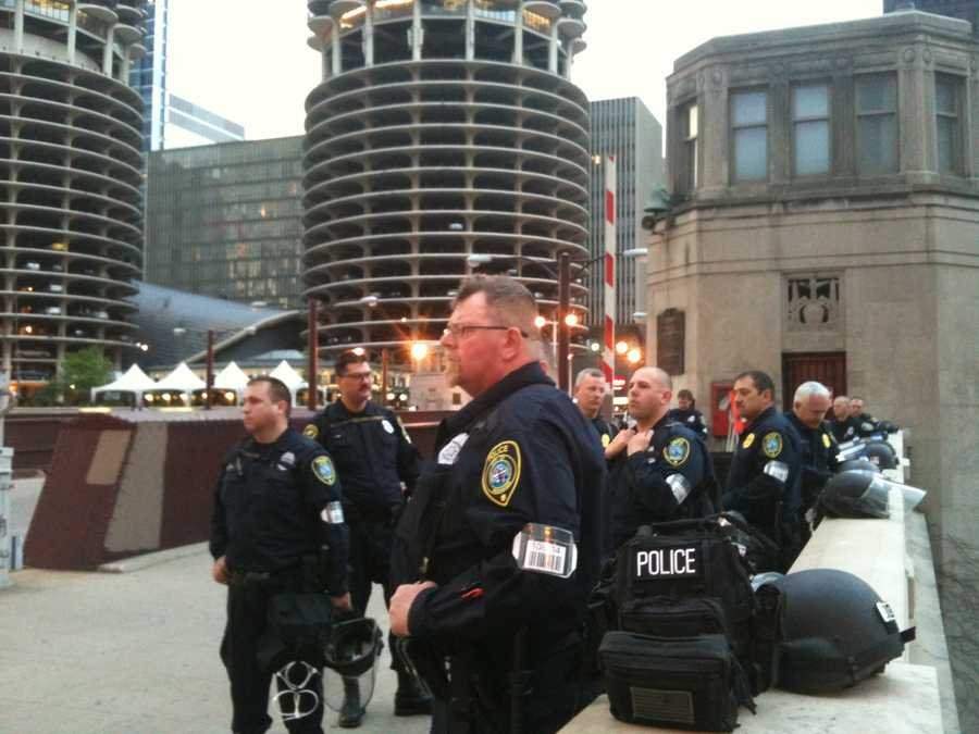 Milwaukee police officers guard the State Street bridge over the Chicago River on Sunday.