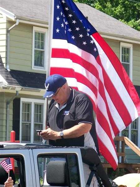 The American Flag is always the Parade Marshal.
