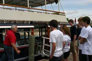 Captain Neill Frame gives some pointers before leaving the dock.