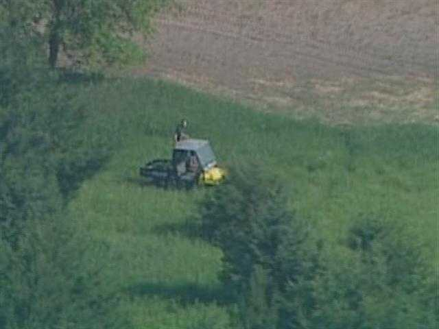 Crews from several agencies searched Friday for a 14-year-old Oconomowoc boy in a marshy area southwest of the city.