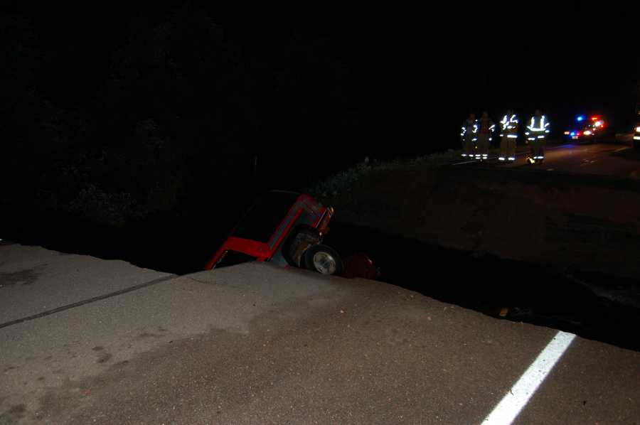 Three people are dead after two vehicles crashed into an area where the road appeared to have washed out by heavy rains in Clark County on June 21, 2012.