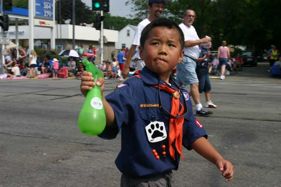 Scouts spray the crowd to help keep people cool.