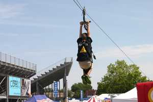 Music On The Move Plus showcases the only mobile zip line in the Midwest at the 2012 Wisconsin State Fair.