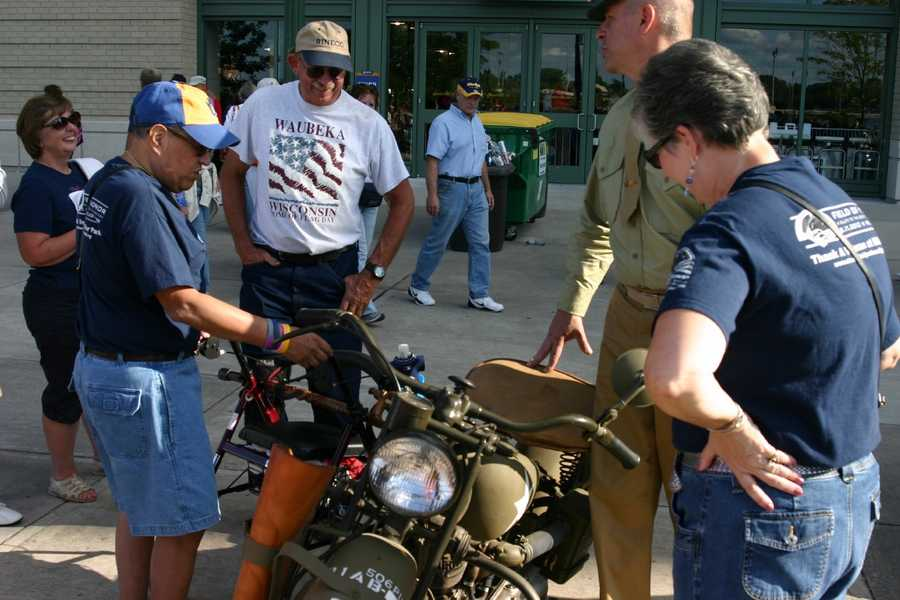 WWII era vehicles and classic cars were also on display outside the stadium.