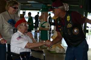 The Patriot Guard Riders were on hand to thank the vets and help direct them inside the stadium.
