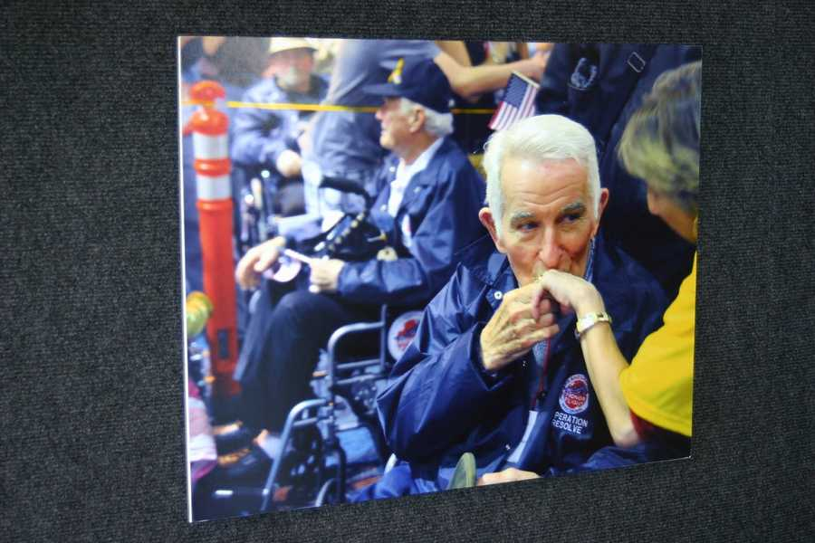 """A series of """"the best of"""" photos from past Honor Flights were on display."""