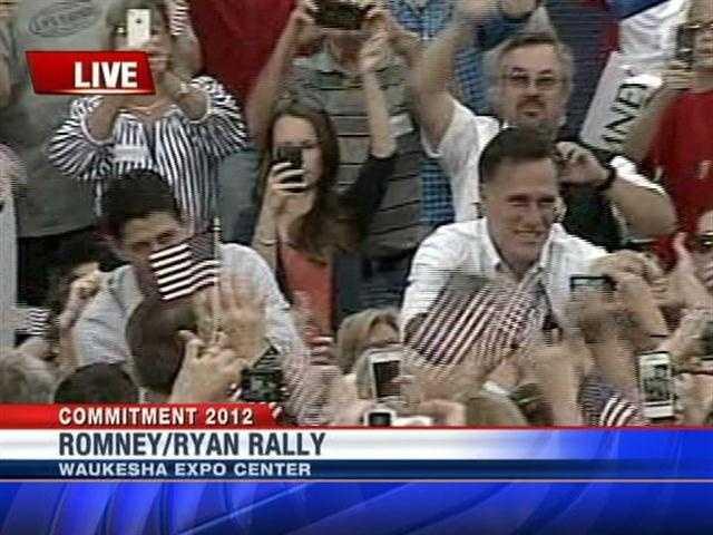 Mitt Romney and Paul Ryan walk through crowd.