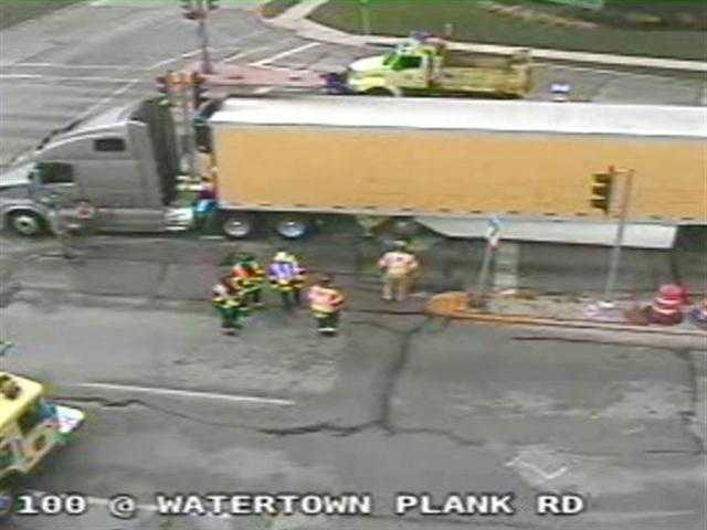 A crash between a semi-truck and a county vehicle closed the lanes of Highway 100 at Watertown Plank Road Thursday afternoon.