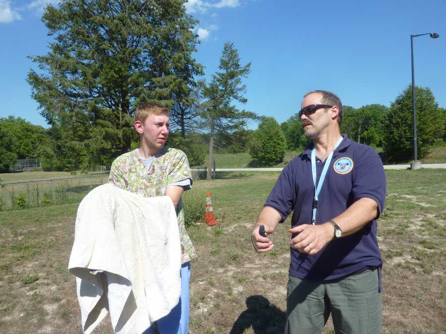 Chris Staupe, a wildlife rehabilitator, gets final instructions from Scott Diehl, WHS's Wildlife Manager, about how to release Olympia (waiting under the towel to keep her calm).