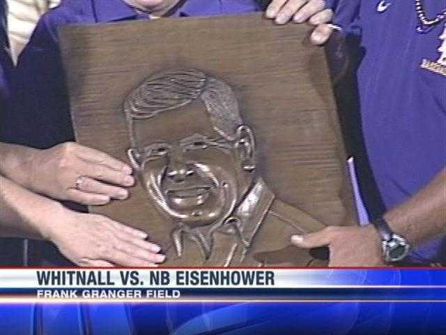 Former New Berlin Eisenhower coach Frank Granger is honored before the team took on Whitnall.