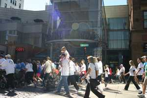 Walking down past The Show of Grand Avenue.