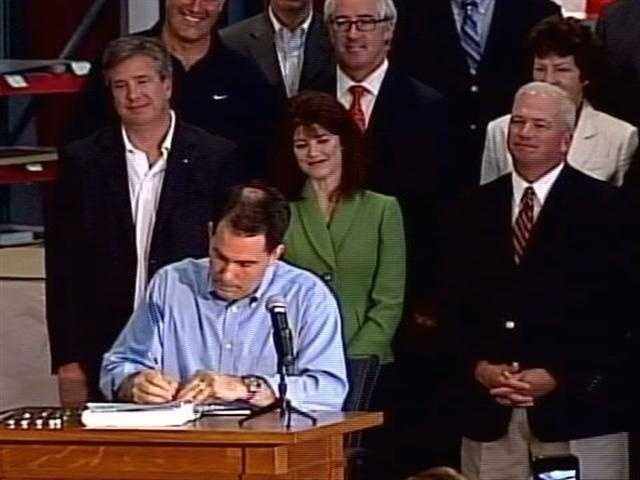 March 11, 2011 - Gov. Walker signs the bill, Act 10, into law. He also rescinds the layoff notices for the 1,500 state employees issued earlier. The Democratic State Senators returned the next day.