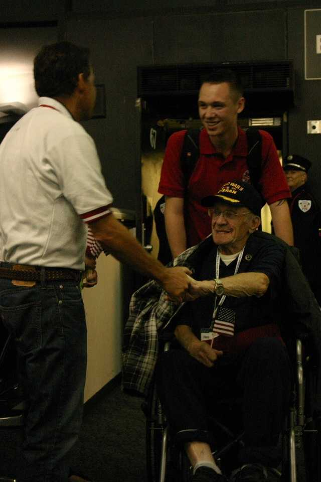 Joe Dean, SSHF Chairman of the Board, was among the first people to greet the vets as they got off the plane.