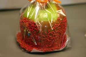 Volunteers helped decorate the apples.